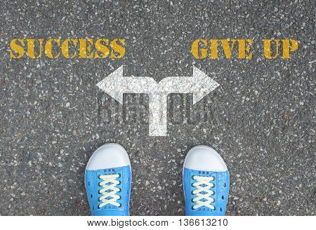 One standing at the crossroad choosing what to do next - success or give up