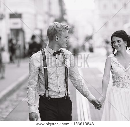 the bride and groom posing for the camera on the streets of the old town