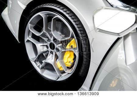 Close up of a modern sport wheel with yellow brake