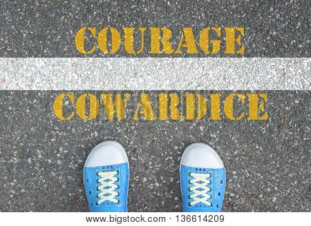 Blue shoes standing at the line between cowardice and courage