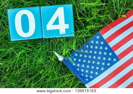 July 4th wooden color calendar on blue background. Summer day. Empty space for text. Independence Day Of America.