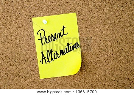 Present Alternatives Written On Yellow Paper Note