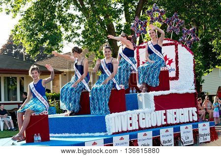 SOUTH ST. PAUL, MINNESOTA - JUNE 24, 2016: Miss Inver Grove Heights Royalty waves from float during annual South St. Paul Kaposia Days Grande Parade on June 24.