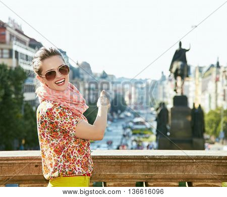 Happy Woman Pointing On Statue At Wenceslas Square In Prague
