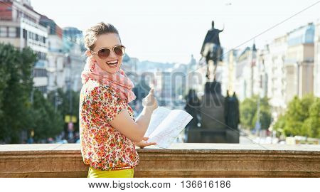 Woman With Map Pointing On Statue At Wenceslas Square In Prague
