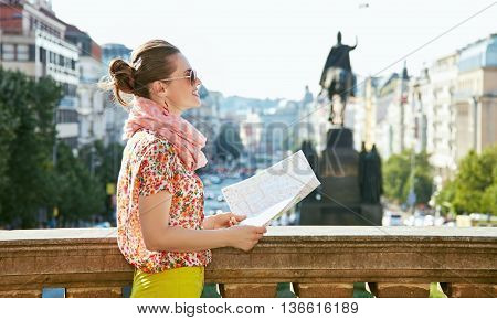 Smiling Woman With Map Standing Near National Museum In Prague