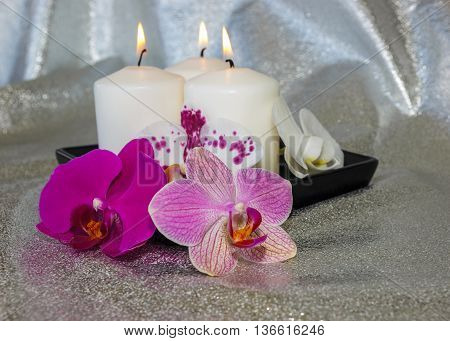 Phalaenopsis Flowers (orchid) And Burning Candles