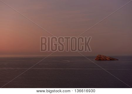 Beautiful sunset over the Benidorm Island and the Mediterranean Sea. Tranquil and breathtaking landscape. The island is uninhabited but many tourists visiting the island. Spain