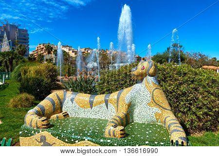 Tiger shaped tiled bench in Marina d'Or garden. Oropesa del Mar resort town. Spain