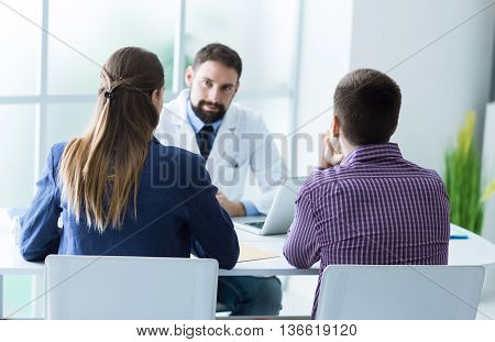 Young Couple At The Doctor's Office