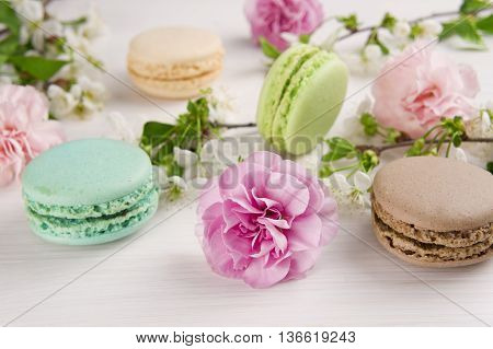 French macaroons. Turquoise chocolate and green colors. Spring concept.