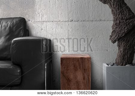 black sofa wooden table with root sculpture hard concrete wall in gray living room