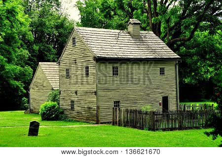 Ephrata Pennsylvania June 6 2015: Circa 1740's wooden home of founder Conrad Beissel at the 18th century Ephrata Cloister Germanic religious settlement