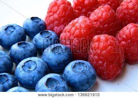 Closeup Of A Bunch Of Raspberries And Blueberries