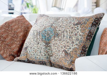 the two pillows with a Arabic pattern