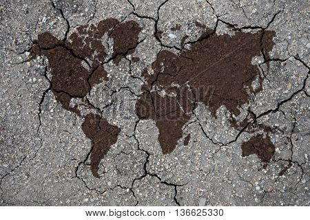 dry clay texture and world map concept for global warming