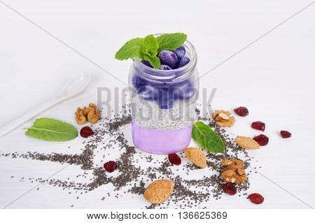 Chia seeds pudding with blueberries. Yogurt chia seeds on a white background top view. Healthy food and diet concept