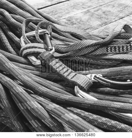 Climbing Rope And Equipment On Wooden Boards