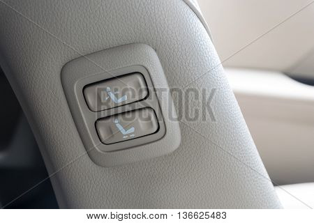 Buttons for adjusting seat position. adjust, adjustment