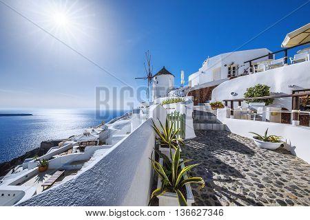 Oia village with sun Santorini island Greece