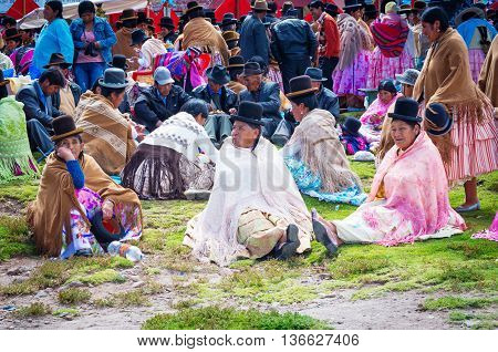 Copacabana Bolivia-March 23 2015:Bolivian women in traditional clothes on the street Copacabana.