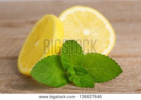 fresh lemons and mint on wooden background.