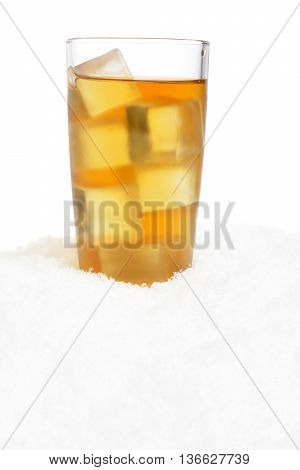 Ice tea with ice cubes on snow on white background