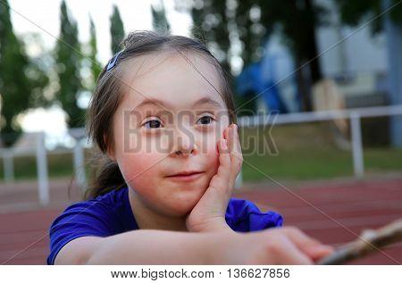 Little girl have fun on the stadium .