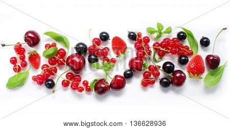 Various fresh summer berries. Ripe cherries strawberries and currant. Berries on white background. Top view