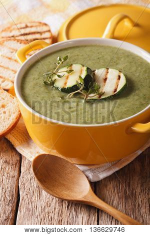 Summer Zucchini Soup With Thyme Close-up In A Saucepan. Vertical