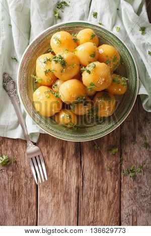 Glazed New Potatoes With Parsley Close-up On The Table. Vertical Top View