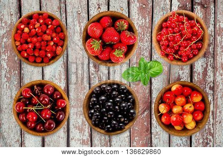 Set various berries. Strawberries currant cherry. Collection of different fruits and berries isolated on white. Ripe and tasty berryon old wooden background.