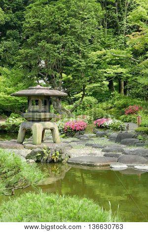 Vertical Japanese Outdoor Stone Lantern In The Zen Garden
