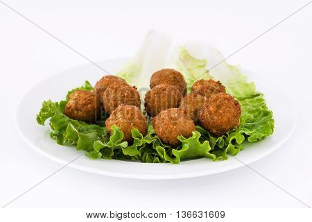 Vegetarian falafels and lettuce isolated on white background
