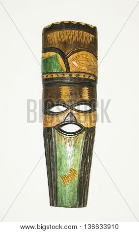 Wooden ethnic tribal ritual handmade mask isolated on white background. South Africa. Souvenir.