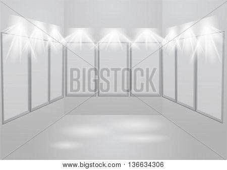 gallery light. white empty frames illuminated by spotlights