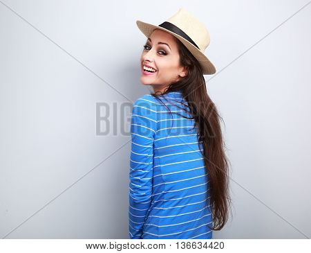 Beautiful Long Hair Laughing Woman In Blue Top And Straw Hat Looking
