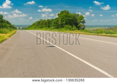 Morning landscape with high-way near Krasnograd city in central Ukraine