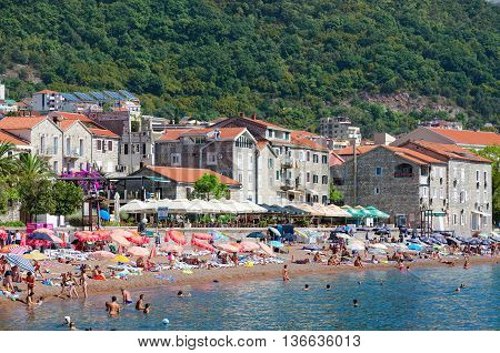 PETROVAC MONTENEGRO - SEPTEMBER 19 2015: Unidentified people are relaxing on beach in popular resort town of Petrovac Montenegro