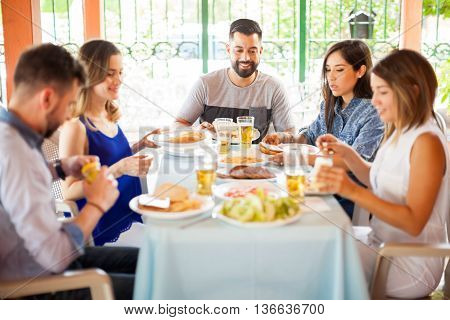 Group Of Friends Eating Hamburgers Outdoors