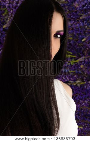 beautiful brunette woman with straight hair in studio