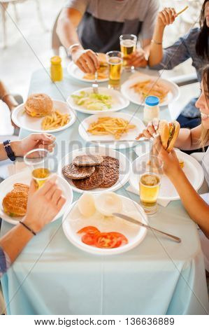 Friends Eating Hamburgers Together