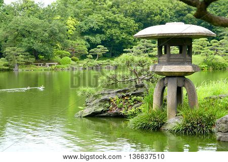 Three Ducks And Stone Lantern In Zen Garden Pond