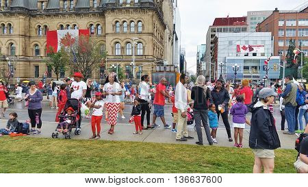 OTTAWA CANADA - JULY 1 2016 : Canadians celebrating Canada Day in downtown Ottawa Ontario.