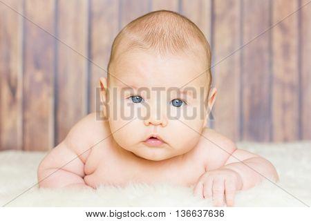 Cute Baby Lying On Fur