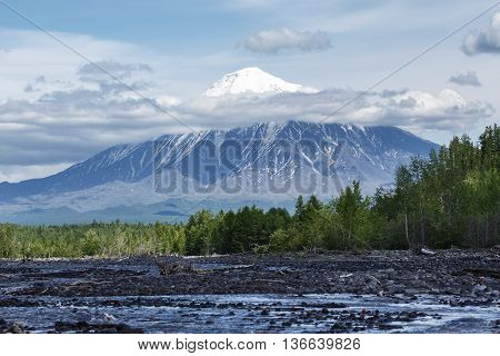 Beautiful summer volcanic landscape of Kamchatka Peninsula: view on Ostry Tolbachik Volcano on a sunny day. Eurasia Russian Far East Kamchatsky Region Klyuchevskaya Group of Volcanoes.