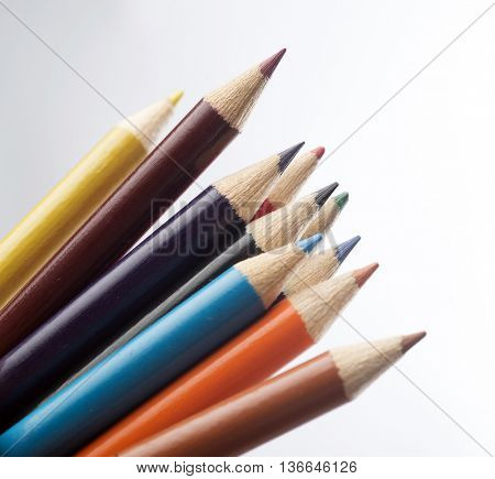 ten colored pastels isolated on light grey