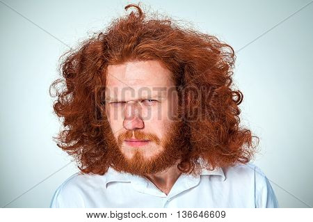 The young angry man with long red hair