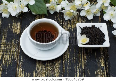 Jasmine tea with jasmine flower on table background