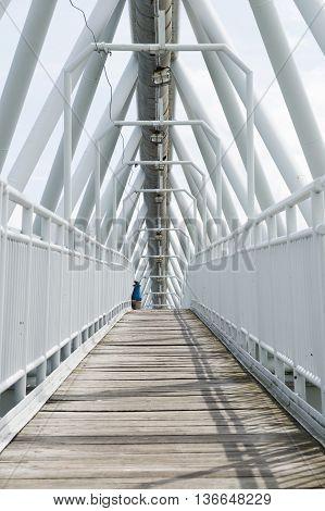 Clean and empty white suburban bridge with wooden floor